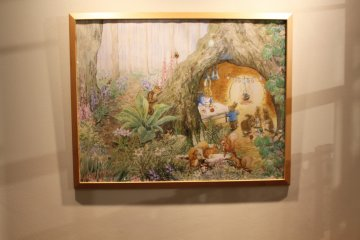 <p>One of many Peter Rabbit style paintings that hang across the walls</p>