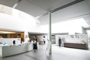 The wide and open main hall is lit up by natural light filtering from above, giving it a airy and welcoming feel.