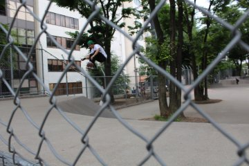 Using objects as a frame for a photo. Here I used the fence to place a jumping skateboarder inside a square