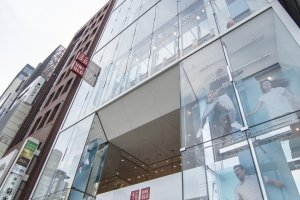 The entirely transparent glass facade of UNIQLO Ginza with rows upon rows of revolving mannequins, making for a hypnotic installation.