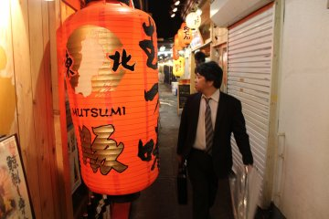 <p>Another local next to a orange glowing lantern</p>