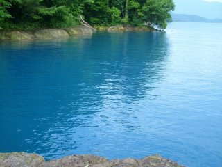 The surface of the lake allows for an easy view of this striking shade of blue