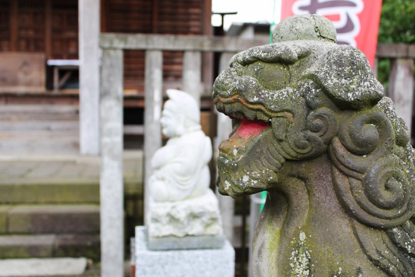 One of the many animal statues at the shrine