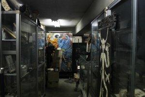 Part of the dimly lit shop.