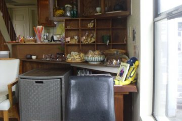 <p>It looks like someone&#39;s house, but with nicely wrapped Western-style treats on the counter</p>