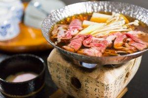 Hida beef sukiyaki simmering over a fire