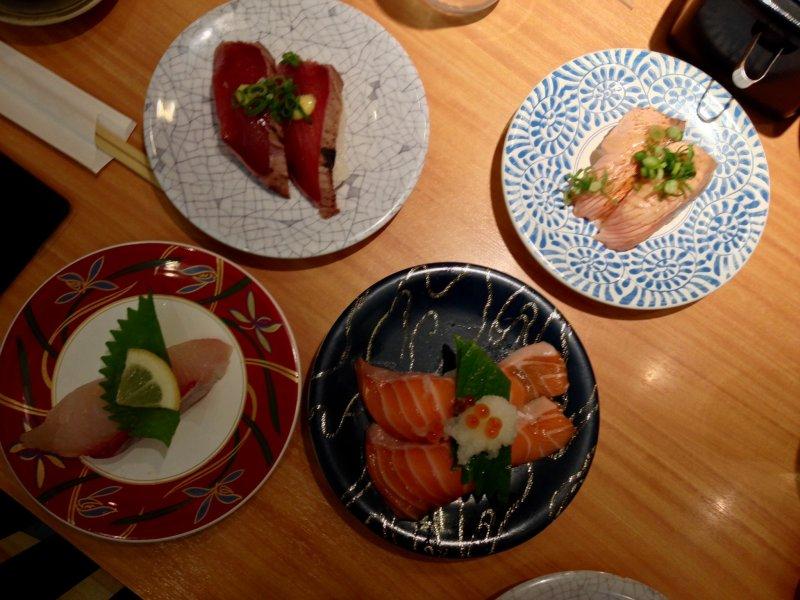 <p>Clockwise from top-left: katsu tataki, the &quot;Mmmm,&quot; inducing aburi shio negi salmon, salmon toro and kanpachi</p>