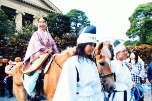 The priestess rides to the ceremony area