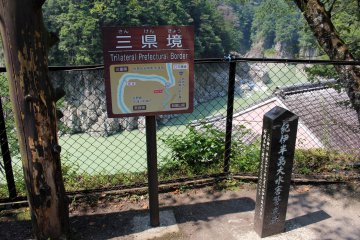 <p>The conjunction of 3 prefectures: the photo was taken inside Nara, Mie is directly across the river from the sign and the cliffs at the left hand bend are in Wakayama</p>