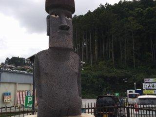 A closeup of the moai outside Sun Sun Shopping Village