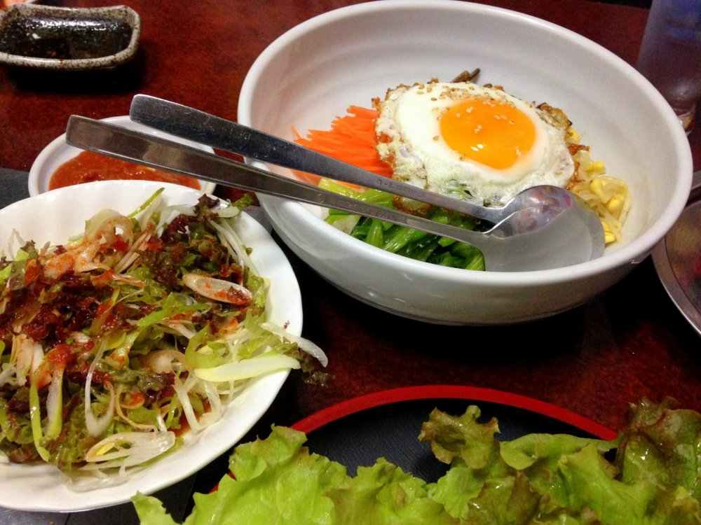A set of Bibimbap, rice mixed with assorted herbs and vegetables, meat and fried egg, to complement the Samgyeupsal. The side dishes are superb!