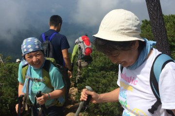 <p>Hikers make a descent after a rest on top of Mt. Shibutsu.</p>