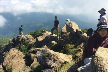 <p>Hikers enjoy a break at the top of Mt. Shibustu at about 9:15 a.m.</p>