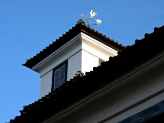 Weather vane on one of the school houses