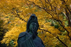 There is a huge statue of Guanyin in the garden