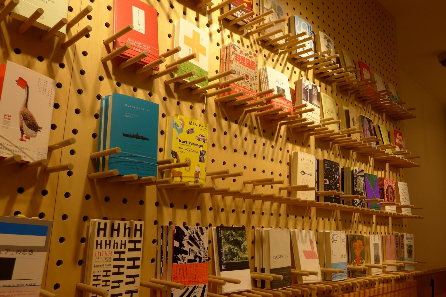 There are many books you can borrow, displayed on the walls of the cafe.