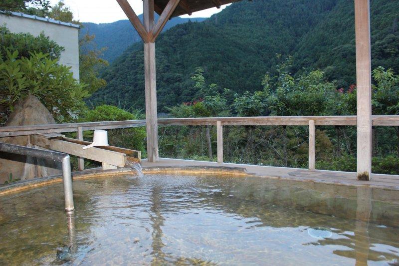 <p>The outdoor cedar wood bath at Sugi no Yu Hotel</p>