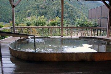<p>The outdoor cedar wood hot spring bath</p>