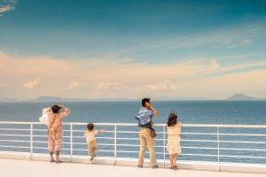 A family enjoys the fresh clean air on their voyage