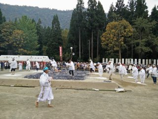 Devotees walk across the hot coals to receive blessings from the mountain gods