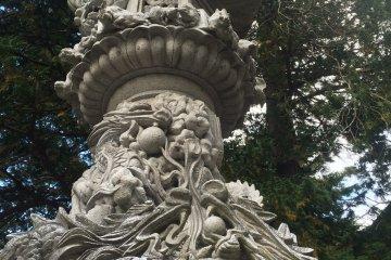 <p>One of the many intricately designed stone lanterns</p>