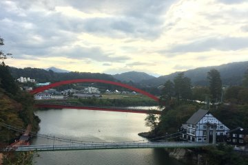 <p>From the temple you can admire the red bridge stretching over the river</p>
