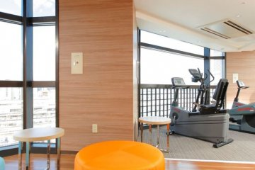 <p>The gym on the 11th floor offers a view over Utsunomiya Station</p>