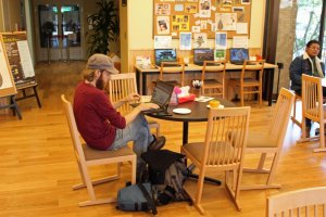 A traveler takes advantage of the Visitors Center's freeWi-Fi