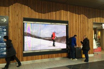 Flat screen digital displays promote tourism in Nagano.
