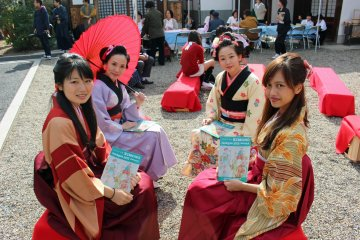 <p>Kimono clad students from the Nara University of Medicine hold up the Jazzgle&#39;s event booklet &nbsp;</p>