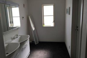 <p>A long mirror at the hallway</p>
