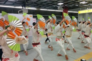 Riders were greeted by dozens of suzume-odori dancers as one of the many special performances during the subway ride