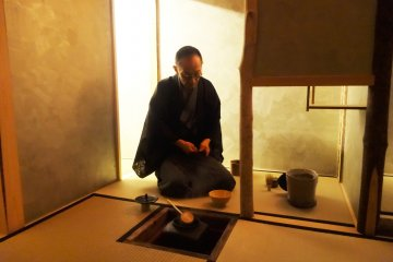 <p>Doi-san performs a tea ceremony for guests</p>