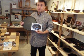 Mr. Kirimoto displaying his work