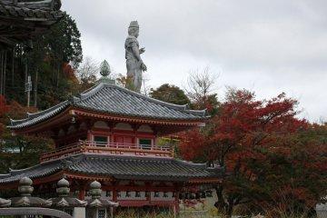 <p>The standing Buddha rises above the Jigendo Hall.</p>