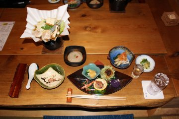 <p>The kaiseki course dinner. Yamato chicken nabe hot pot is in the top left</p>