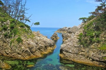 A small stream meets the Sea of Japan at this point