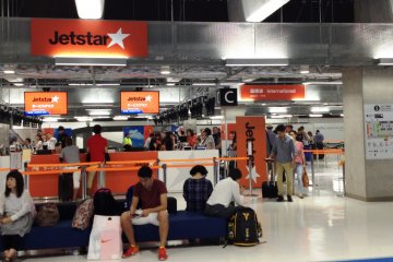 Jetstar International operates from Terminal 3. Be sure to have enough time to pick up your luggage from the domestic flight and then queue up for the check in.