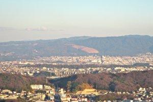 The grassy slopes of Wakakusa Mountain, Nara Park and Nara City from a view point near Hozanji Temple
