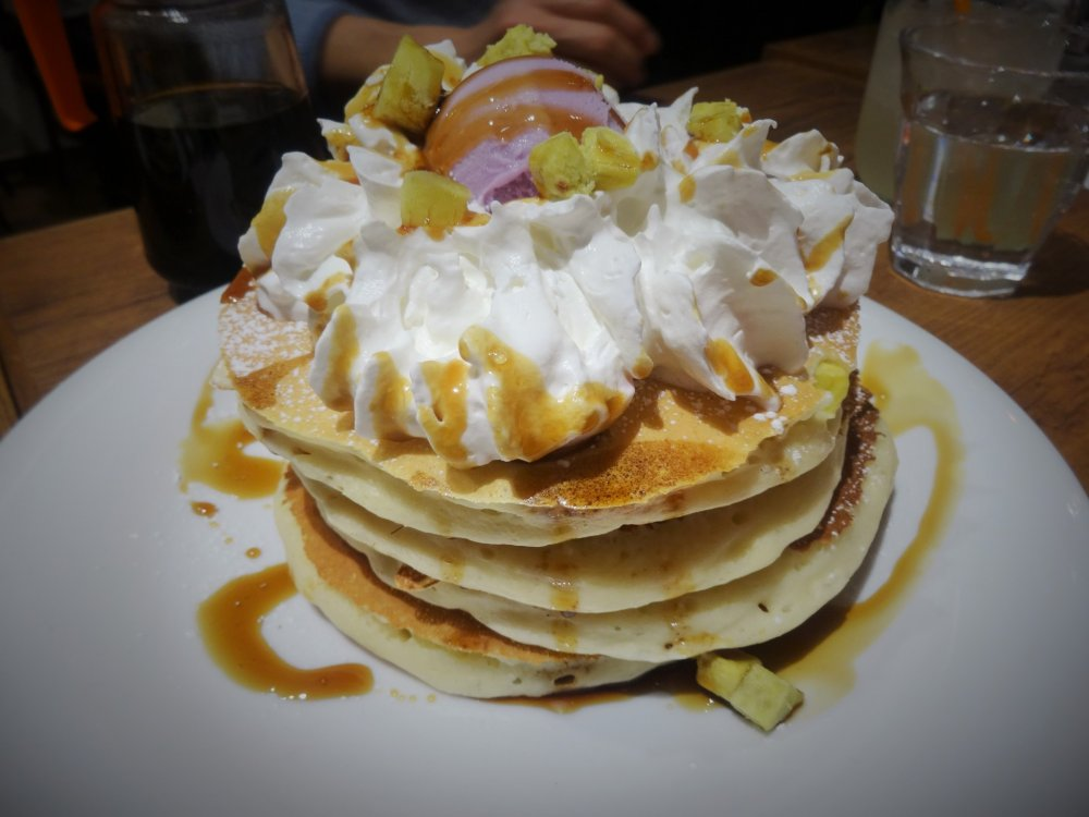 A full stack of sweet potato pancakes at Koa Pancake House