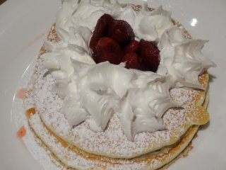 Strawberry pancakes with a healthy dollop of whipped cream