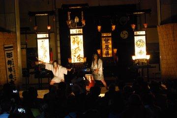 Large kiriko lanterns spend just enough light to the strange spectacle.