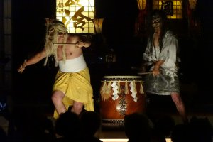 Wild-looking characters and powerful drumming put the audience in a trance.