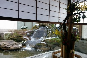 <p>A garden waterfall seen from the lobby, next to the entrance</p>