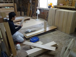 Each employee deals with one step of the furniture making process - here making drawers