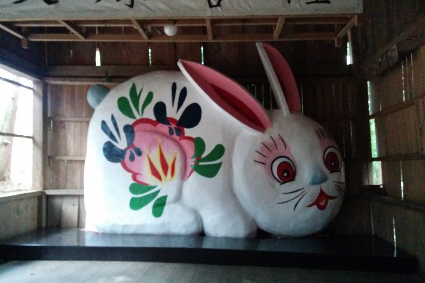 Too cute, and too big! A massive cheerful bunny hides inside the shrine gate