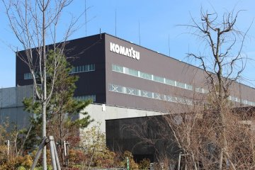 The current Komatsu company headquarters stands overlooking the parkland