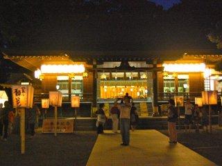 The shrine and lanterns casting mystical light