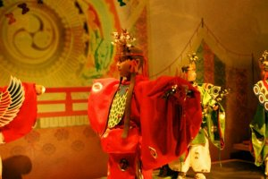 Models of traditional court dancers