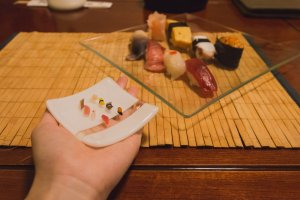 Miniature sushi platter in the palm of my hands